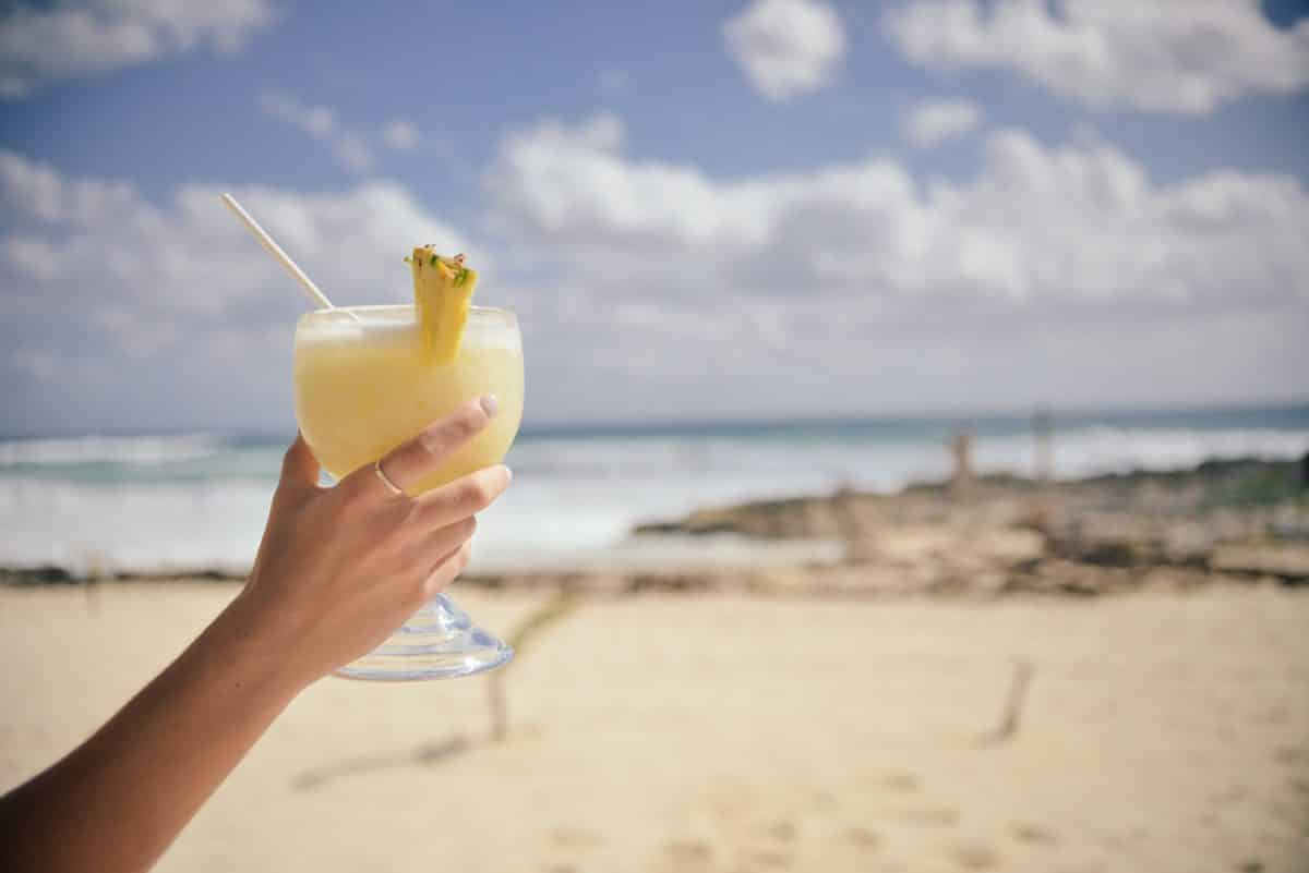 Drink in hand on a beach